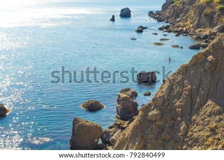 Picturesque and precipitous shore of the summer sea #792840499