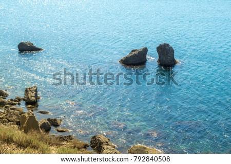 Picturesque and precipitous shore of the summer sea #792840508