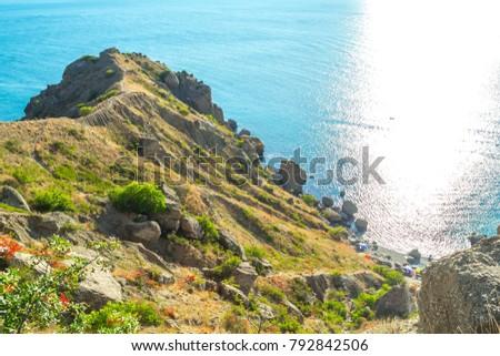 Picturesque and precipitous shore of the summer sea #792842506