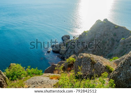 Picturesque and precipitous shore of the summer sea #792842512
