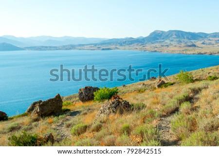 Picturesque and precipitous shore of the summer sea #792842515