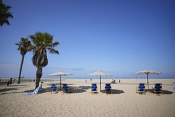Picturesque atmosphere of beach with parasols and beach chairs in Santa Monica. 12 August 2021, California, USA.