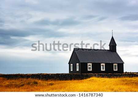 Picturesque autumn landscape with famous picturesque black church of Budir at Snaefellsnes peninsula region in Iceland