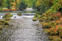 Picturesque autumn view of a Park. The English garden (Englischer Garten) in Munich. The popular holiday destination of citizens and tourists