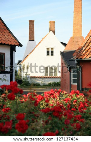 Picturesque backstreet in small town Gudhjem, Denmark, Bornholm by early morning
