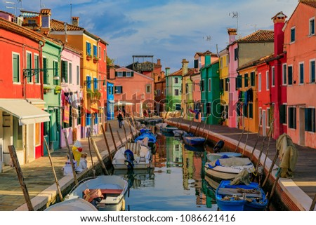 Picturesque canal and bright and colorful houses in Burano island near Venice Italy, which is known for lace making. #1086621416