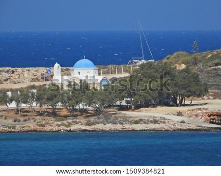 Photo of  Picturesque chapel of Agios Fokas in Parikia next to port of Paros island, Cyclades, Greece