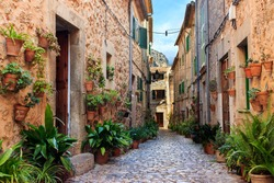 Picturesque cobbled narrow street in Valldemossa town, Majorca Balearic Islands