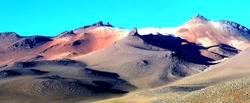 Picturesque colored mountains in the desert of Salvador Dali,Bolivia. Surrounded by towering volcanoes, rocks indiscriminately located on desert  the scene is surreal as were artist Dali's paintings.