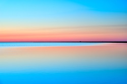Picturesque colorful sky with reflection in water