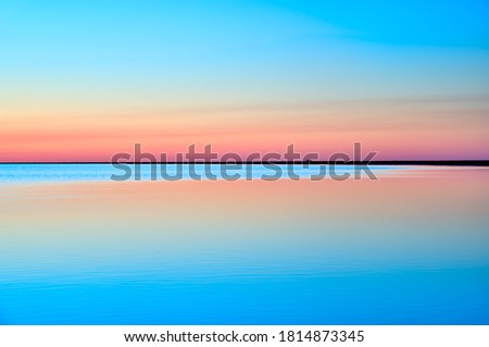 Picturesque colorful sky with reflection in water Foto stock ©