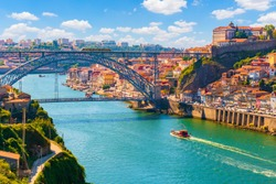 Picturesque, colorful view at old town Porto, Portugal with bridge Ponte Dom Luis over Douro river.