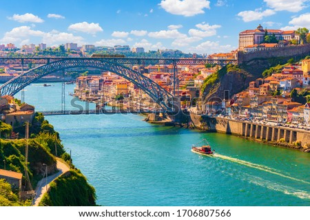 Picturesque, colorful view at old town Porto, Portugal with bridge Ponte Dom Luis over Douro river. Stockfoto ©