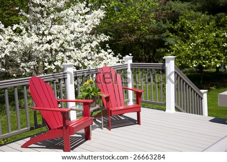 Picturesque deck with a blooming dogwood tree