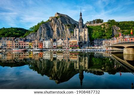 Picturesque Dinant town, Dinant Citadel and Collegiate Church of Notre Dame de Dinant and Pont Charles de Gaulle bridge over Meuse river. Belgian province of Namur, Blegium Photo stock ©