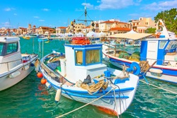 Picturesque fshing boats in the port of Aegina town on summer sunny day, Greece