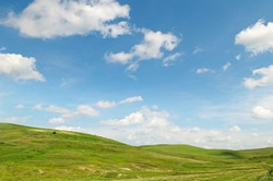 picturesque hills against the blue sky