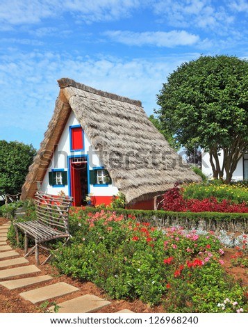 Picturesque house-museum of the first colonists to Madeira. Charming white cottage with a thatched roof and gable small garden with flowers