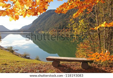 picturesque lake view in autumn, with a wooden bench, bavarian lake sylvenstein