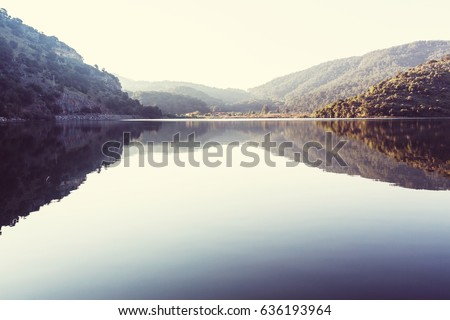 Picturesque lake with calm water.