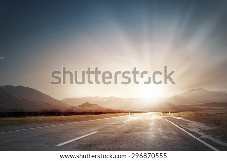 Picturesque landscape scene and sunrise above road #296870555