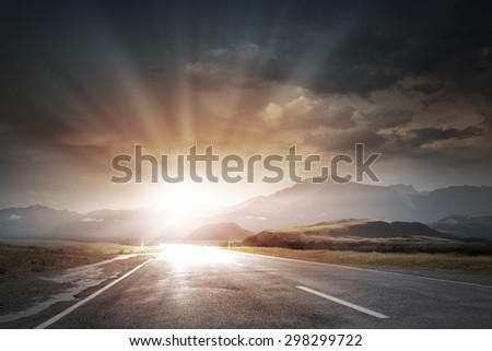 Picturesque landscape scene and sunrise above road #298299722