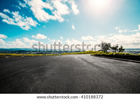 Picturesque landscape scene and sunrise above road #410188372