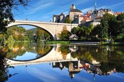 Picturesque landscape with bridge and castle Loket. Czech republic