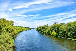 picturesque moscow city moskva river canal nature landmark with forest park scenery reflection on water against blue sky background. Urban landscape. Summer in city. Wide view