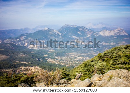 Picturesque mountain landscape. Amazing mountain view with the colorful cloudy sky, natural outdoor travel background. Beauty nature. #1569127000