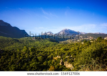 Picturesque mountain landscape. Amazing mountain view with the colorful cloudy sky, natural outdoor travel background. Beauty nature. #1569127006