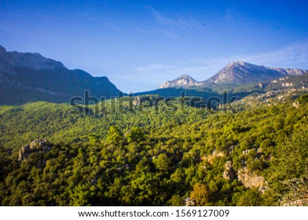 Picturesque mountain landscape. Amazing mountain view with the colorful cloudy sky, natural outdoor travel background. Beauty nature. #1569127009