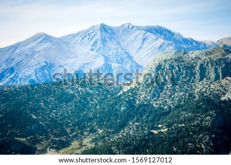 Picturesque mountain landscape. Amazing mountain view with the colorful cloudy sky, natural outdoor travel background. Beauty nature. #1569127012
