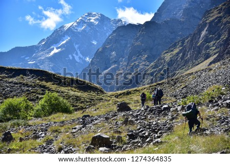 Picturesque mountain landscapes of high mountain valleys. People in the mountains. Landscapes of mountain rivers and valleys. #1274364835