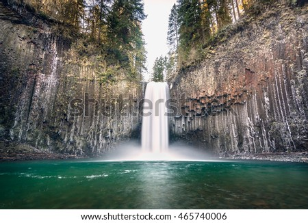 Picturesque of Beautiful waterfalls in winter flowing over the lava rock formation. The name is Abiqua Falls located in Oregon, USA