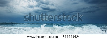 Picturesque panoramic view of a beach in Vlissingen, Netherlands. Storm sea, waves and water splashes close-up. Natural texture. Epic seascape. Travel destinations, sailing, cruise, vacations, nature Stock photo ©