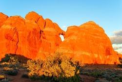 Picturesque red-brown sandstone cliffs form a unique landscape. Grandiose rock compositions natural origin. The unique beauty of Arches Park in USA.