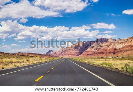 Picturesque road in Arizona. red stone cliffs and blue sky