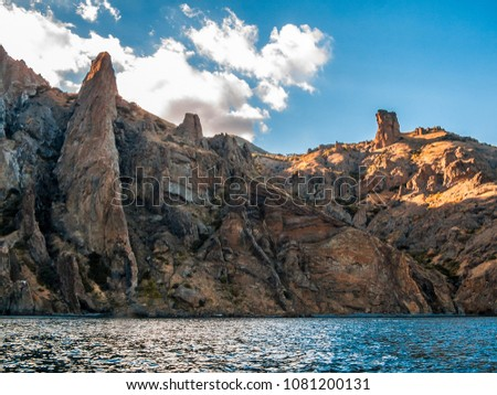 Picturesque rocks on the Black Sea coast - the extinct volcano Kara-Dag. East Crimea, near the village of Koktebel. Evening.