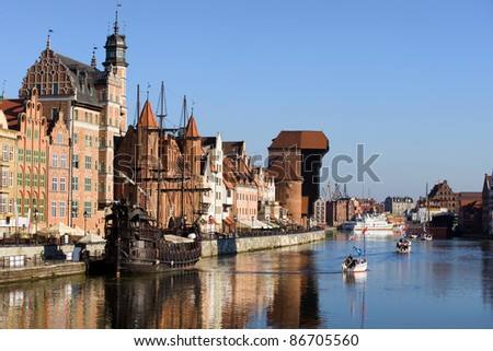 Picturesque scenery in the Old Town of Gdansk in Poland with Motlawa river and The Crane at the far end.