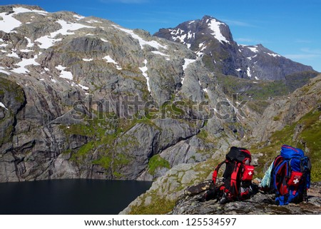 Picturesque scenery on Lofoten islands in Norway with two backpacks