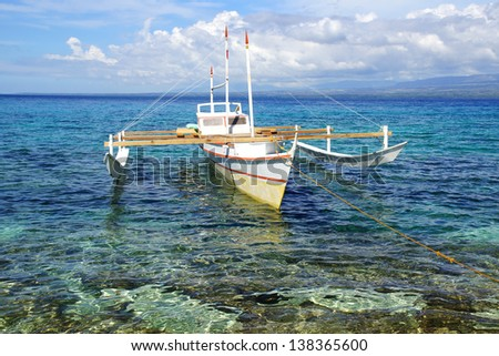 Picturesque seascape with bangka. Apo Island, Philippines,