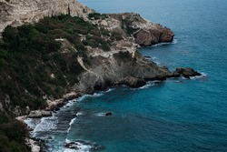 Picturesque seascape with rocky cliffs, stones, sea bay. Beautiful blue sea and cliffs near Sevastopol