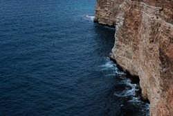 Picturesque seascape with rocky cliffs, stones, sea bay. high cliffs on the shore of the Black sea in Crimea