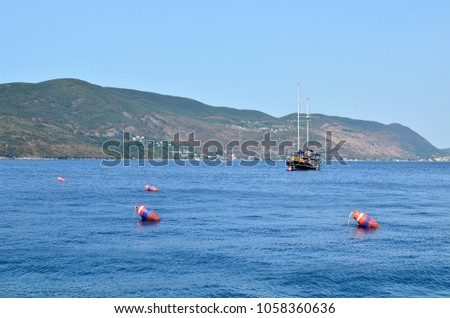Picturesque ship on a blue sea while cruising during a day #1058360636