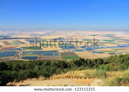 Picturesque squares colored fields of the valley of Galilee. Photographed from Mount Barkan - stock photo