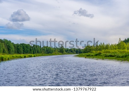 Picturesque summer landscape with northern river and forest in summer cloudy day. Travelling and discovering distant places of Earth. View from floating boat. Chernaya river, Karelia, Russia #1379767922