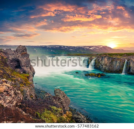 Picturesque summer morning scene on the Godafoss Waterfall. Colorful sunrise on the on Skjalfandafljot river, Iceland, Europe. Artistic style post processed photo. #577483162