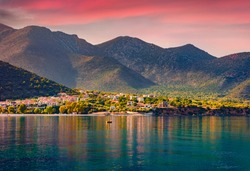 Picturesque summer view of Kyparissi village. Amazing sunset on Peloponnese peninsula, Greece, Europe. Calm morning seascape of Myrtoan Sea. Traveling concept background.