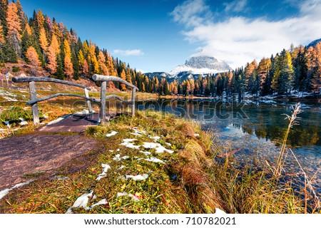 Picturesque sunny scene of Antorno lake with Tre Cime di Lavaredo (Drei Zinnen) mount. Colorful autumn landscape in Dolomite Alps, Belluno, Italy, Europe. Beauty of nature concept background.